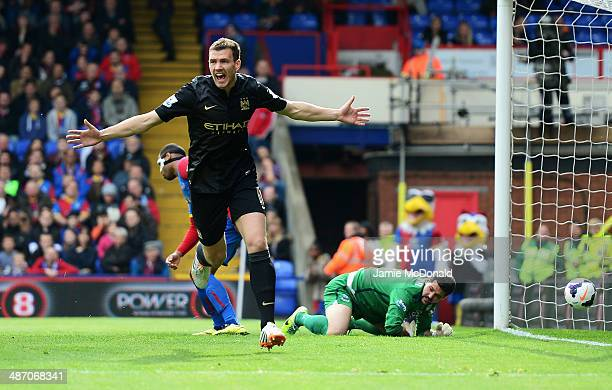 Edin Dzeko of Manchester City celebrates scoring the opening goal during the Barclays Premier League match between Crystal Palace and Manchester City...