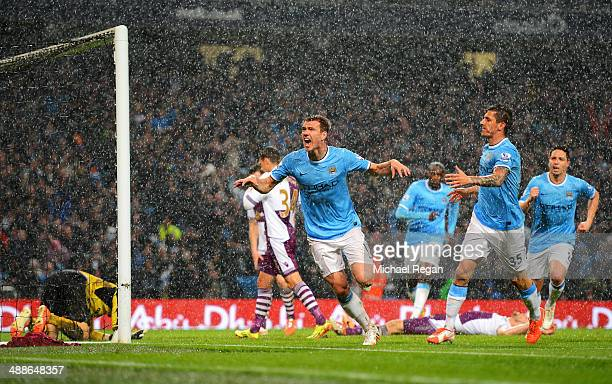 Edin Dzeko of Manchester City celebrates scoring the opening goal during the Barclays Premier League match between Manchester City and Aston Villa at...