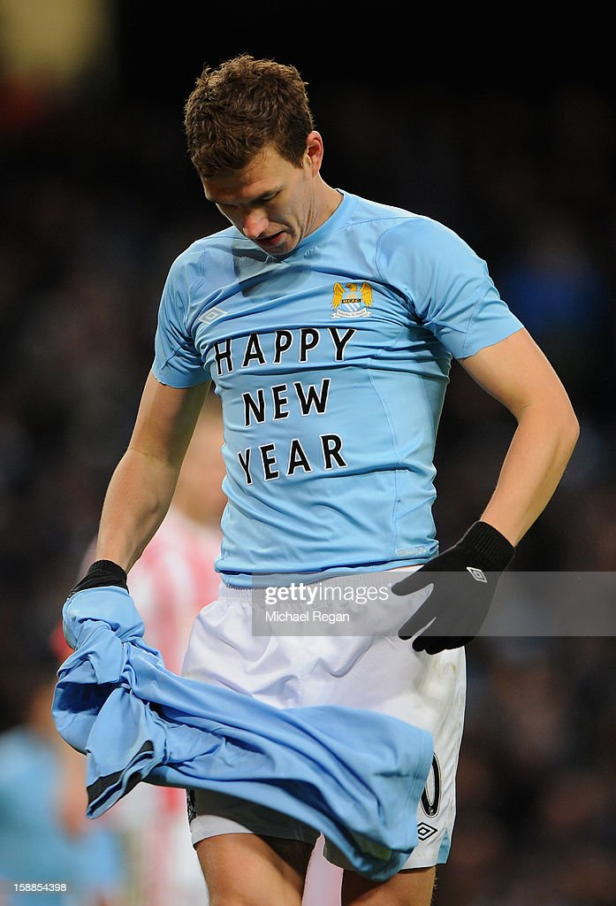 <a gi-track='captionPersonalityLinkClicked' href=/galleries/search?phrase=Edin+Dzeko&family=editorial&specificpeople=4404455 ng-click='$event.stopPropagation()'>Edin Dzeko</a> of Manchester City celebrates scoring the second goal during the Barclays Premier League match between Manchester City and Stoke City at the Etihad Stadium on January 1, 2013 in Manchester, England.