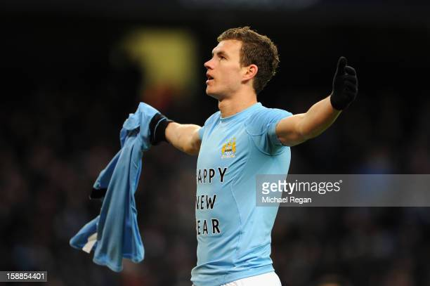 Edin Dzeko of Manchester City celebrates scoring the second goal during the Barclays Premier League match between Manchester City and Stoke City at...