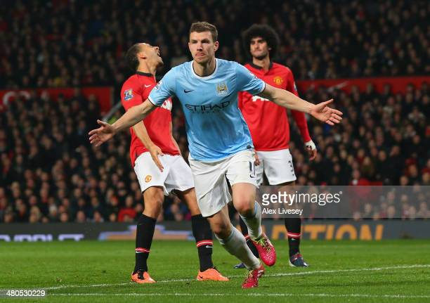 Edin Dzeko of Manchester City celebrates scoring the second goal during the Barclays Premier League match between Manchester United and Manchester...