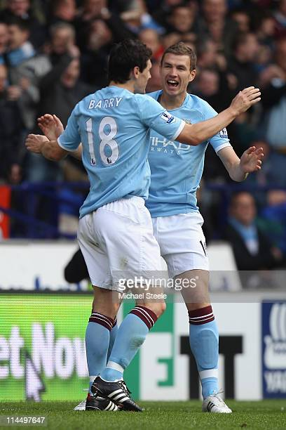 Edin Dzeko of Manchester City celebrates scoring the second goal with Gareth Barry during the Barclays Premier League match between Bolton Wanderers...