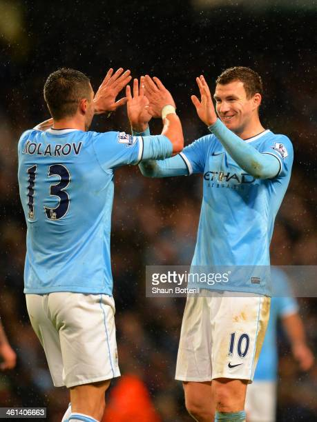Edin Dzeko of Manchester City celebrates scoring their sixth goal with Aleksandar Kolarov of Manchester City during the Capital One Cup SemiFinal...