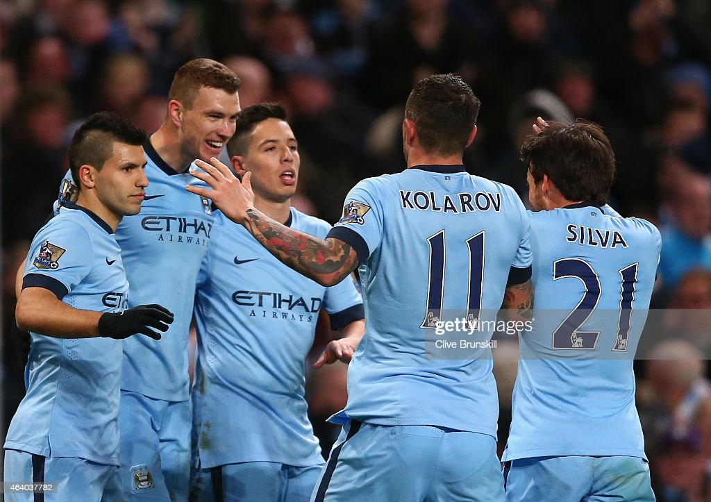 <a gi-track='captionPersonalityLinkClicked' href=/galleries/search?phrase=Edin+Dzeko&family=editorial&specificpeople=4404455 ng-click='$event.stopPropagation()'>Edin Dzeko</a> of Manchester City celebrates scoring their third goal with team mates during the Barclays Premier League match between Manchester City and Newcastle United at Etihad Stadium on February 21, 2015 in Manchester, England.