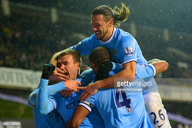 Edin Dzeko of Manchester City celebrates scoroing their third goal with team mates during the Barclays Premier League match between Tottenham Hotspur...