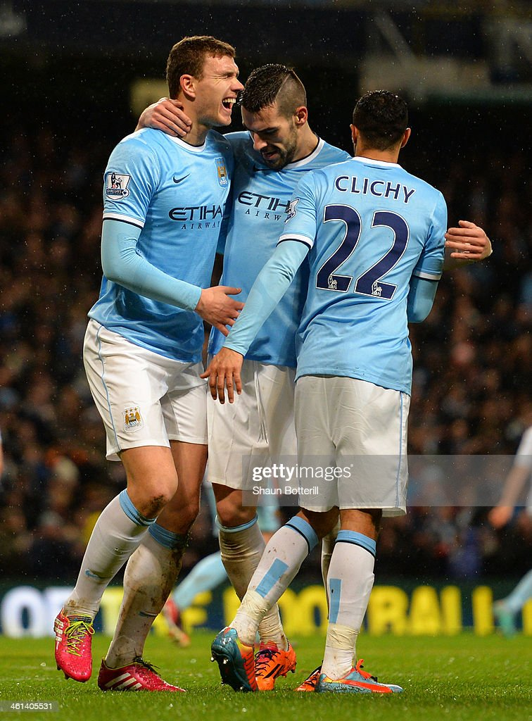 Edin Dzeko of Manchester City celebrates with team mates after socring their fifth goal during the Capital One Cup Semi-Final first leg match between Manchester City and West Ham United at Etihad Stadium on January 8, 2014 in Manchester, England.