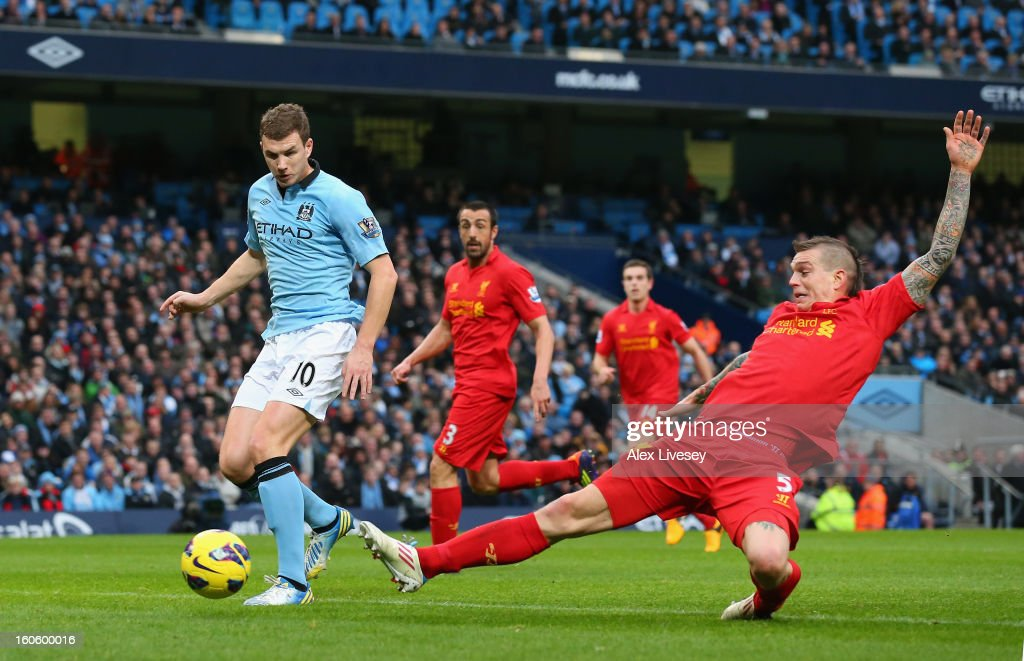 <a gi-track='captionPersonalityLinkClicked' href=/galleries/search?phrase=Edin+Dzeko&family=editorial&specificpeople=4404455 ng-click='$event.stopPropagation()'>Edin Dzeko</a> of Manchester City goes past the tackle of <a gi-track='captionPersonalityLinkClicked' href=/galleries/search?phrase=Daniel+Agger&family=editorial&specificpeople=605441 ng-click='$event.stopPropagation()'>Daniel Agger</a> of Liverpool to score the opening goal during the Barclays Premier League match between Manchester City and Liverpool at the Etihad Stadium on February 3, 2013 in Manchester, England.