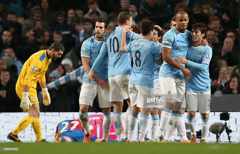 <a gi-track='captionPersonalityLinkClicked' href=/galleries/search?phrase=Edin+Dzeko&family=editorial&specificpeople=4404455 ng-click='$event.stopPropagation()'>Edin Dzeko</a> of Manchester City is congratulated by his team-mates after scoring the opening goal during the Barclays Premier League match between Manchester City and Crystal Palace at the Etihad Stadium on December 28, 2013 in Manchester, England.