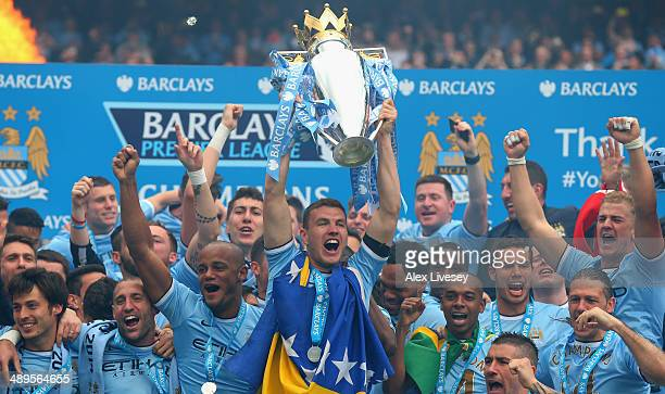 Edin Dzeko of Manchester City lifts the Premier League trophy at the end of the Barclays Premier League match between Manchester City and West Ham...