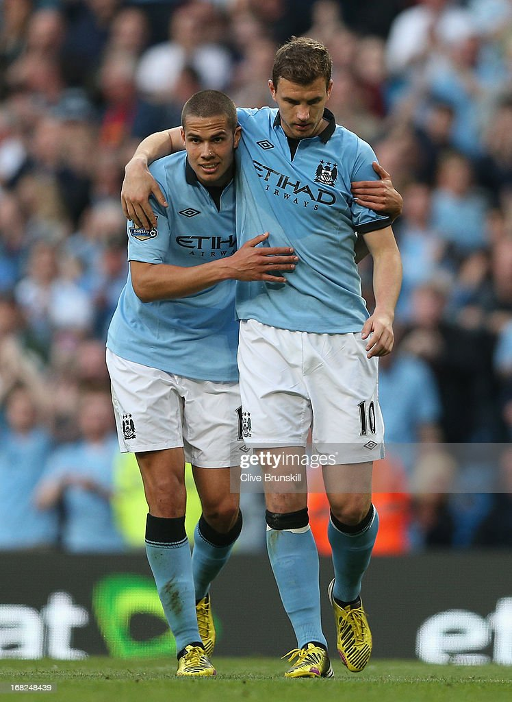 <a gi-track='captionPersonalityLinkClicked' href=/galleries/search?phrase=Edin+Dzeko&family=editorial&specificpeople=4404455 ng-click='$event.stopPropagation()'>Edin Dzeko</a> of Manchester City looks on after scoring the opening goal with team-mate <a gi-track='captionPersonalityLinkClicked' href=/galleries/search?phrase=Jack+Rodwell&family=editorial&specificpeople=4266551 ng-click='$event.stopPropagation()'>Jack Rodwell</a> (l) during the Barclays Premier League match between Manchester City and West Bromwich Albion at the Etihad Stadium on May 07, 2013 in Manchester, England.