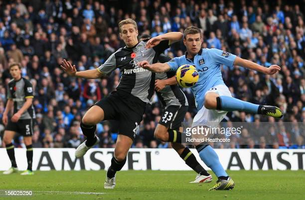 Edin Dzeko of Manchester City scores his team's second goal during the Barclays Premier League match between Manchester City and Tottenham Hotspur at...