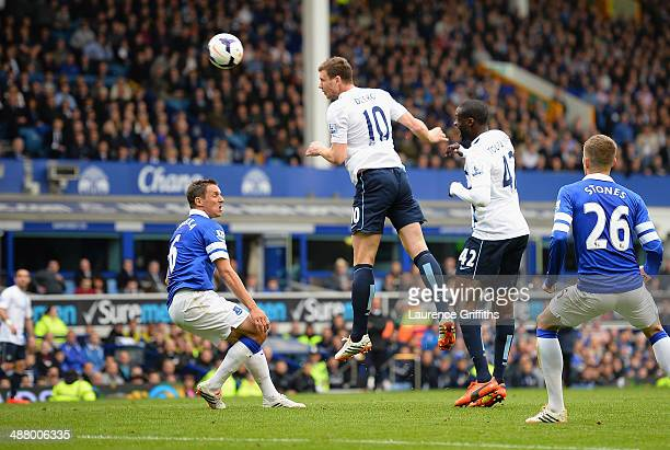 Edin Dzeko of Manchester City scores his team's second goal during the Barclays Premier League match between Everton and Manchester City at Goodison...