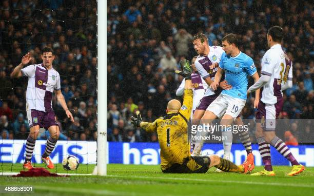 Edin Dzeko of Manchester City scores his team's second goal during the Barclays Premier League match between Manchester City and Aston Villa at...