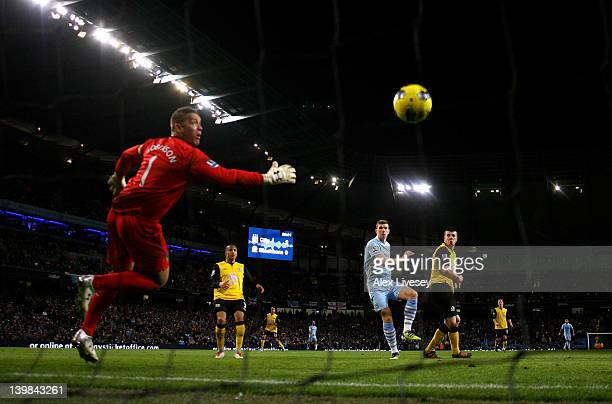 Edin Dzeko of Manchester City scores his team's third goal during the Barclays Premier League match between Manchester City and Blackburn Rovers at...
