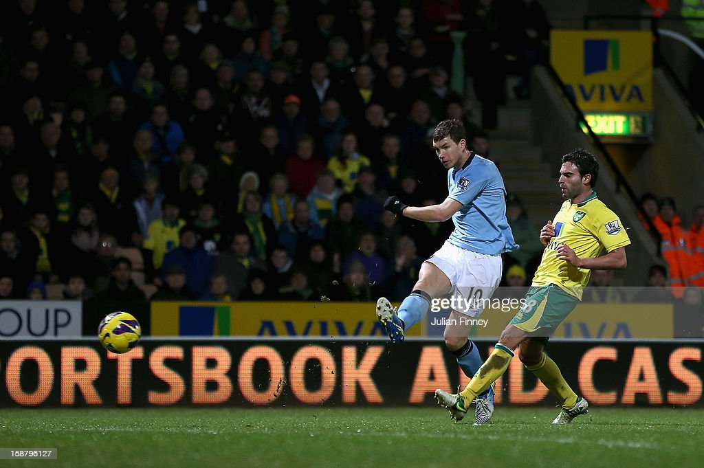 Edin Dzeko of Manchester City scores his third goal and his side's fourth during the Barclays Premier League match between Norwich City and Manchester City at Carrow Road on December 29, 2012 in Norwich, England.