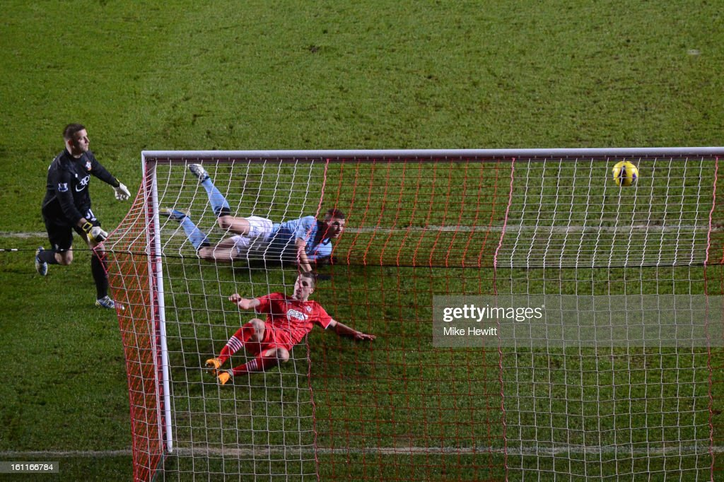 <a gi-track='captionPersonalityLinkClicked' href=/galleries/search?phrase=Edin+Dzeko&family=editorial&specificpeople=4404455 ng-click='$event.stopPropagation()'>Edin Dzeko</a> of Manchester City scores their first goal during the Barclays Premier League match between Southampton and Manchester City at St Mary's Stadium on February 9, 2013 in Southampton, England.