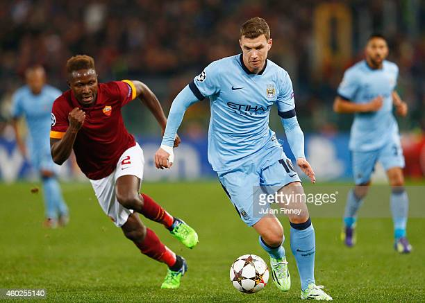 Edin Dzeko of Manchester City takes on Mapou YangaMbiwa of AS Roma during the UEFA Champions League Group E match between AS Roma and Manchester City...