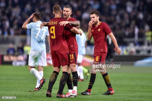 Edin Dzeko of Roma and Aleksandar Kolarov of Roma celebrate the victory at the end of the Serie A match between Roma and Lazio at Olympic Stadium...