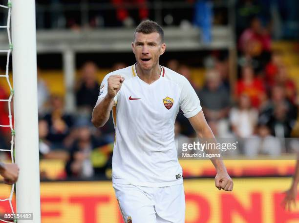 Edin Dzeko of Roma celebrates after scoring the opening goal during the Serie A match between Benevento Calcio and AS Roma at Stadio Ciro Vigorito on...
