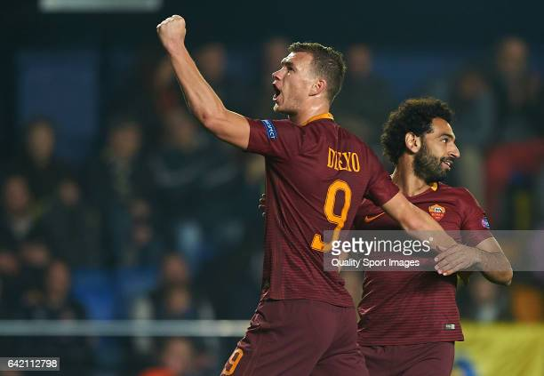 Edin Dzeko of Roma celebrates with Mohamed Salah after scoring a goal during the UEFA Europa League Round of 32 first leg match between Villarreal CF...