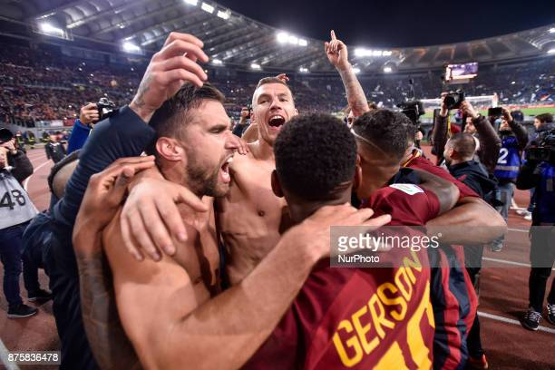 Edin Dzeko of Roma Gerson of Roma and Kevin Strootman of Roma celebrate the victory at the end of the Serie A match between Roma and Lazio at Olympic...
