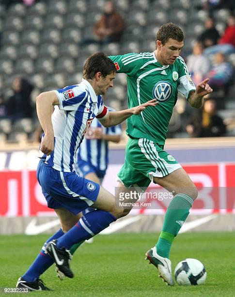 Edin Dzeko of Wolfsburg battles for the ball with Arne Friedrich of Berlin during the Bundesliga match between Hertha BSC Berlin and VFL Wolfsburg at...