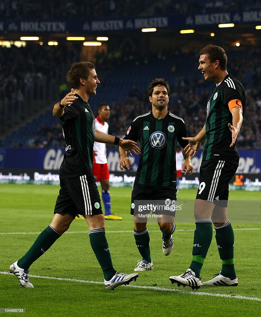 Edin Dzeko (R) of Wolfsburg celebrates after he scores his team's opening goal during the Bundesliga match between Hamburger SV and VFL Wolfsburg at Imtech Arena on September 22, 2010 in Hamburg, Germany.