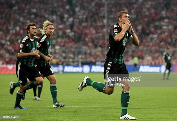 Edin Dzeko of Wolfsburg celebrates after scoring his team's first goal during the Bundesliga match between FC Bayern Muenchen and VfL Wolfsburg at...