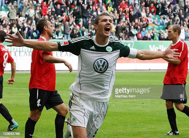Edin Dzeko of Wolfsburg jubilates after scoring the second goal during the Bundesliga match between VFL Wolfsburg and FSV Mainz 05 at Volkswagen...