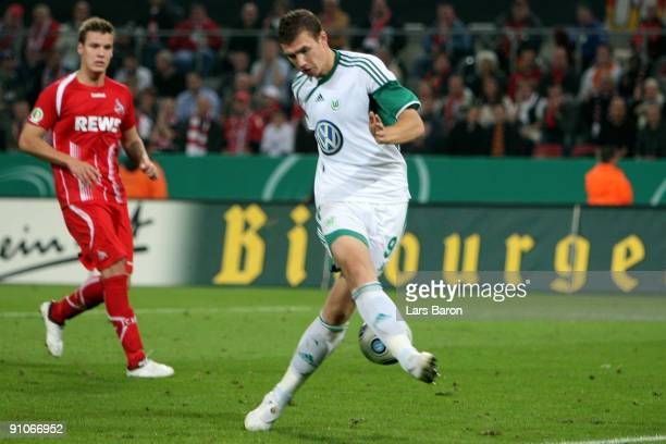 Edin Dzeko of Wolfsburg misses the ball during the DFB Cup second round match between 1 FC Koeln and VfL Wolfsburg at RheinEnergieStadion on...