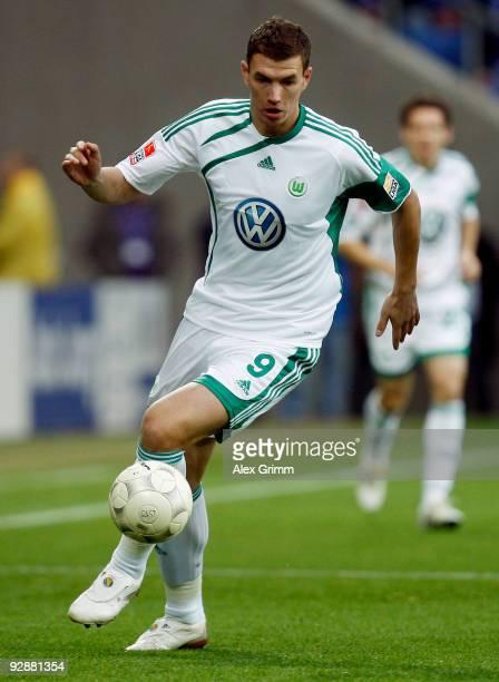 Edin Dzeko of Wolfsburg runs with the ball during the Bundesliga match between 1899 Hoffenheim and VfL Wolfsburg at the RheinNeckar Arena on November...
