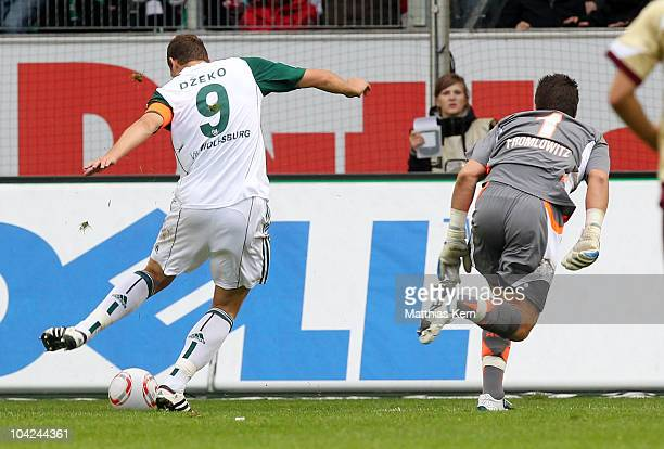 Edin Dzeko of Wolfsburg scores the second goal during the Bundesliga match between VFL Wolfsburg and Hannover 96 at Volkswagen Arena on September 18...
