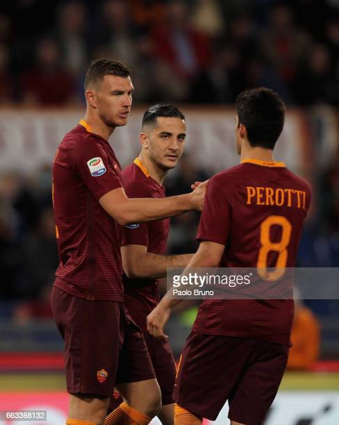 Edin Dzeko with his teammates Kostas Manolas and Diego Perotti of AS Roma celebrates after scoring the team's second goal during the Serie A match...