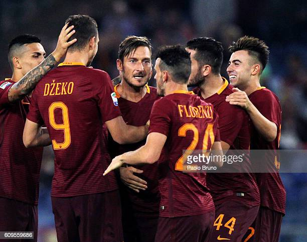 Edin Dzeko with his teammates of AS Roma celebrates after scoring the team's third goal during the Serie A match between AS Roma and FC Crotone at...