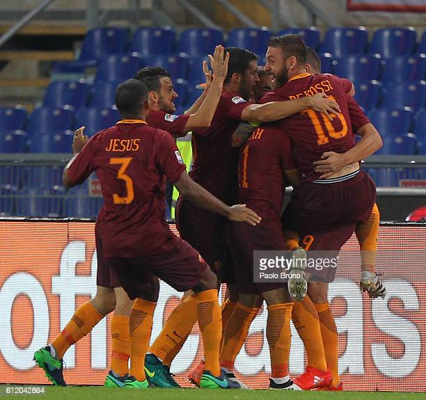 Edin Dzeko with his teammates of AS Roma celebrates after scoring the opening goal during the Serie A match between AS Roma and FC Internazionale at...