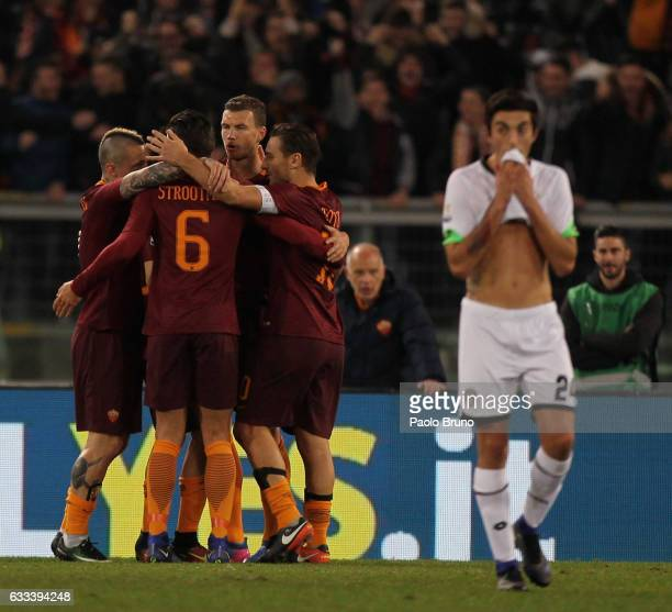 Edin Dzeko with his teammates of AS Roma celebrates after scoring the opening goal during the Serie A match between AS Roma and AC Cesena on February...
