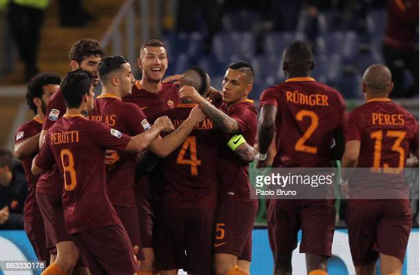 Edin Dzeko with his teammates of AS Roma celebrates after scoring the opening goal during the Serie A match between AS Roma and Empoli FC at Stadio...