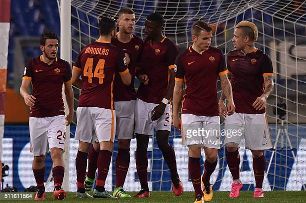 Edin Dzenko of Roma is celebrated after scoring the opening goal during the Serie A match between AS Roma and US Citta di Palermo at Stadio Olimpico...