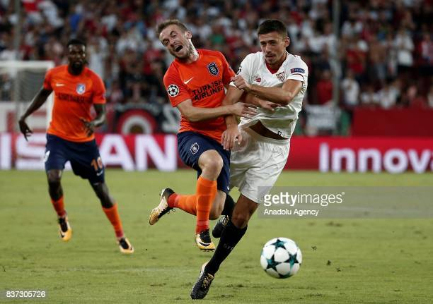 Edin Visca in action against Clement Lenglet of Sevilla during the UEFA Champions League playoff match between Sevilla and Medipol Basaksehir at...
