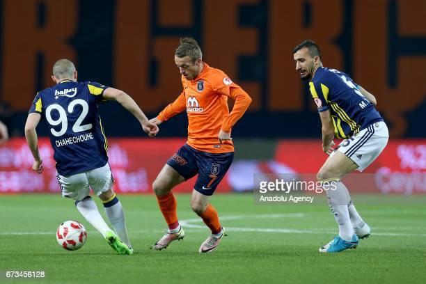 Edin Visca of Medipol Basaksehir in action against Aatif Chahechouhe and Mehmet Topal of Fenerbahce during the Ziraat Turkish Cup semi final soccer...