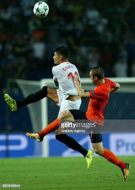 Edin Visca of Medipol Basaksehir in action against Joaquin Correa of Sevilla FC during the UEFA Champions League playoff match between Medipol...