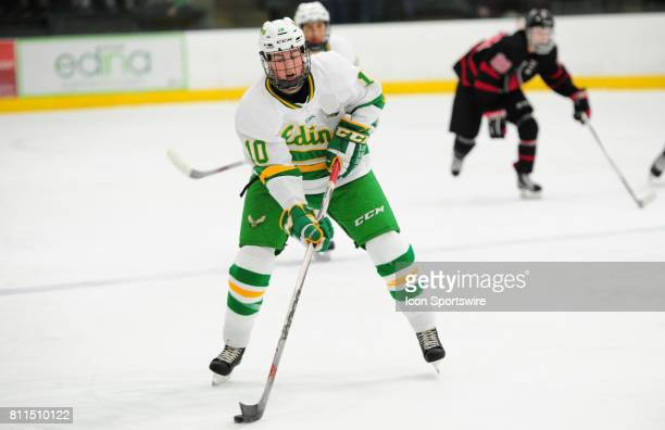 Edina Hornets forward Samuel Walker moves the puck against the Eden Prairie Eagles during their prep hockey game at Braemar Ice Arena in Edina MN on...