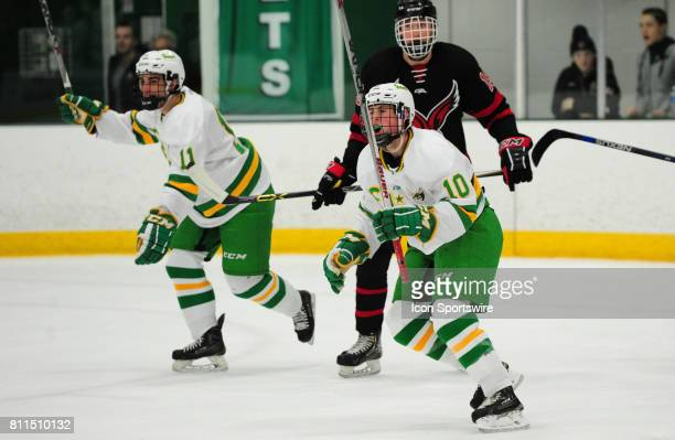 Edina Hornets forwards Samuel Walker and Lewis Crosby celebrate a goal against the Eden Prairie Eagles during their prep hockey game at Braemar Ice...