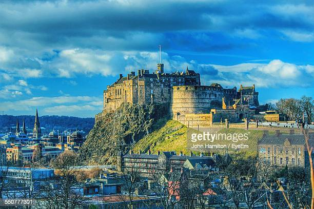 Edinburgh Castle And Houses Against Cloudy Sky