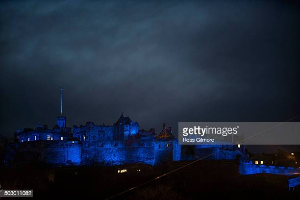 Edinburgh castle is lit up in blue light as Unicef lights up Edinburgh in Blue for New Year's Eve to mark their #HappyBlueYear winter appeal for...