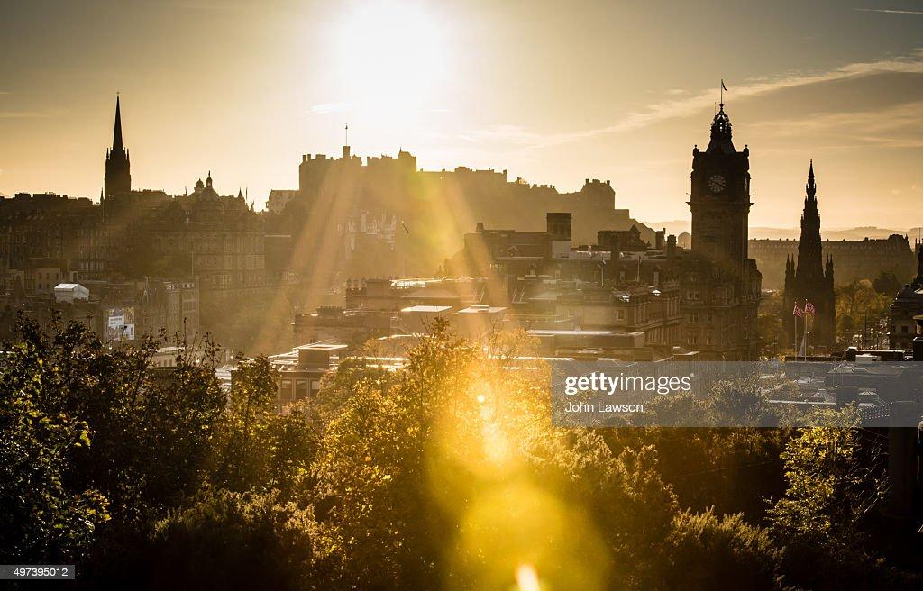 Edinburgh cityscape sunset flare
