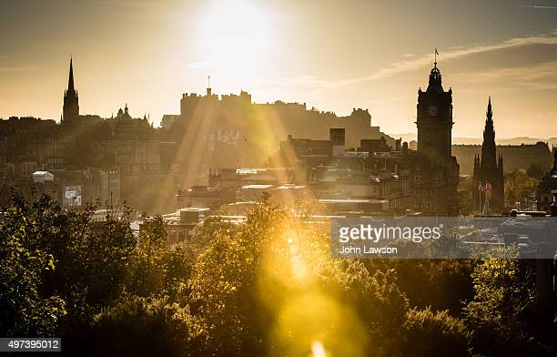 Edinburgh cityscape sunset flare