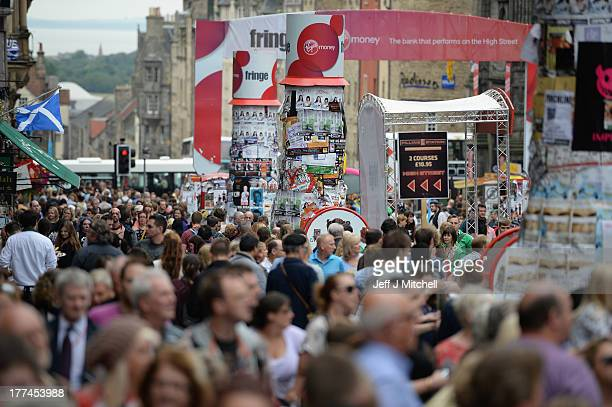 Edinburgh Festival Fringe entertainers perform on the Royal Mile as the festival enters its final weekend on August 23 2013 in Edinburgh Scotland The...