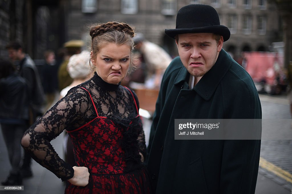 Edinburgh Festival Fringe entertainers perform on the Royal Mile on August 14, 2014 in Edinburgh, Scotland. The largest performing arts festival in the world, this years festival hosts more than 3,000 shows in nearly 300 venues across the city.