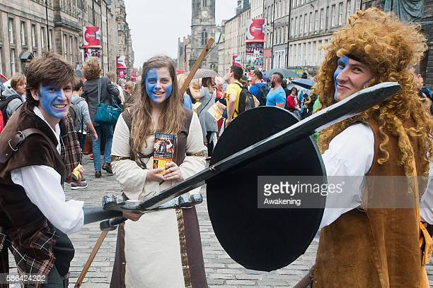 Edinburgh Festival Fringe entertainers perform on the Royal Mile on August 6 2016 in Edinburgh Scotland The largest performing arts festival in the...